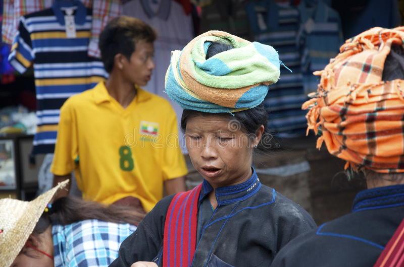 Three local women having a chat at the market. Burma stock images