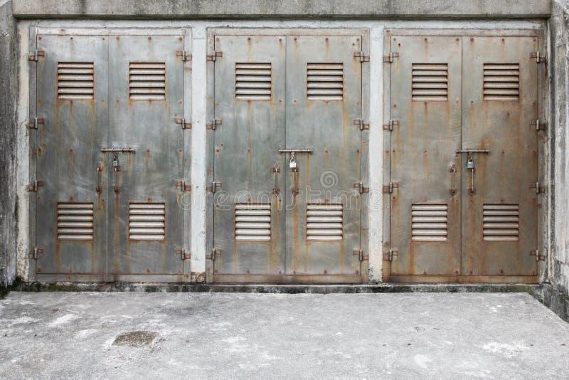 Three locked metal gate royalty free stock images