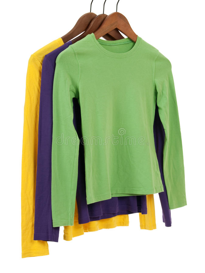 Download Three Long Sleeved Shirts On Wooden Hangers Stock Image - Image: 16784239