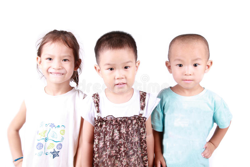 Three lovely children. 3 lovely children stand side-by-side with white background stock image