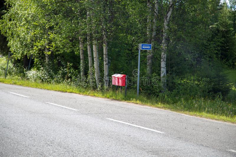 Three mail boxes at a bus stop in Finland royalty free stock photos