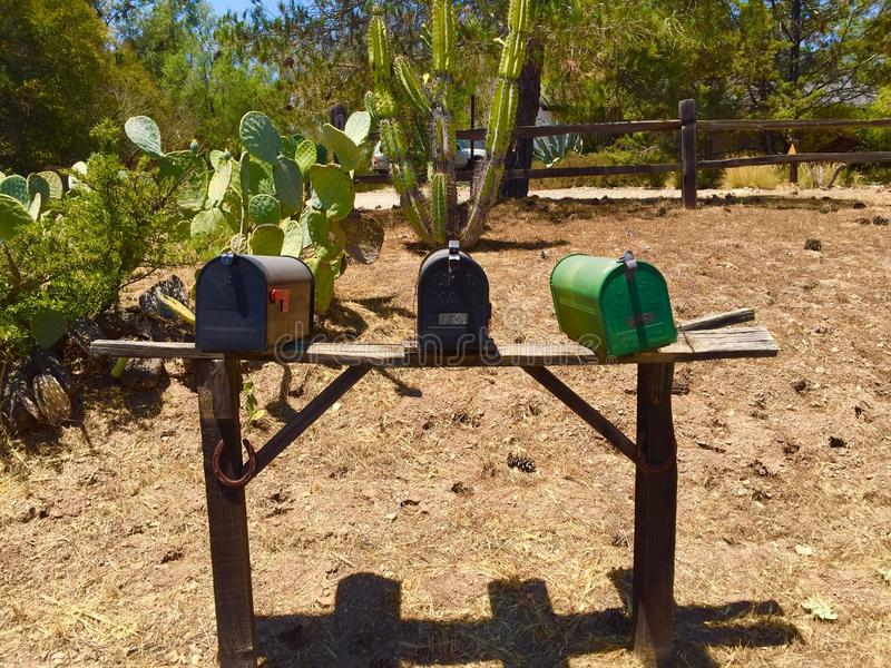 Three mailboxes on country road royalty free stock photography
