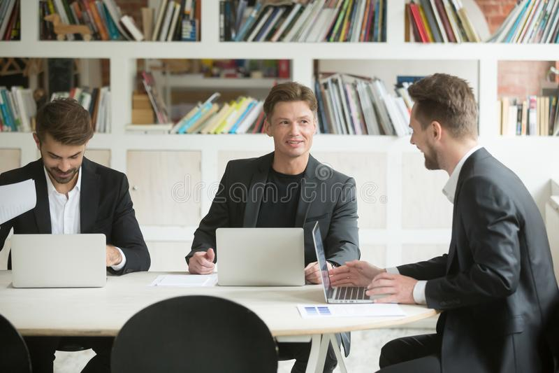 Three male colleagues brainstorming and discussing ideas royalty free stock photos