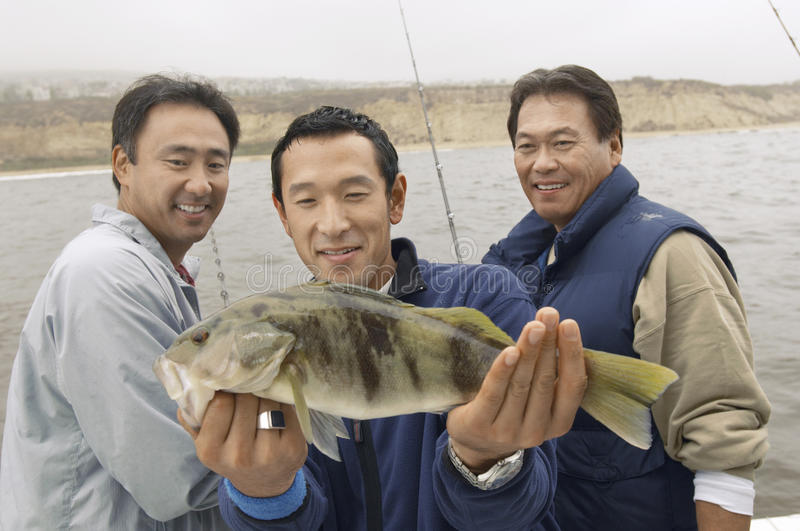 Download Three Male Friends With A Catch Stock Image - Image: 29648411