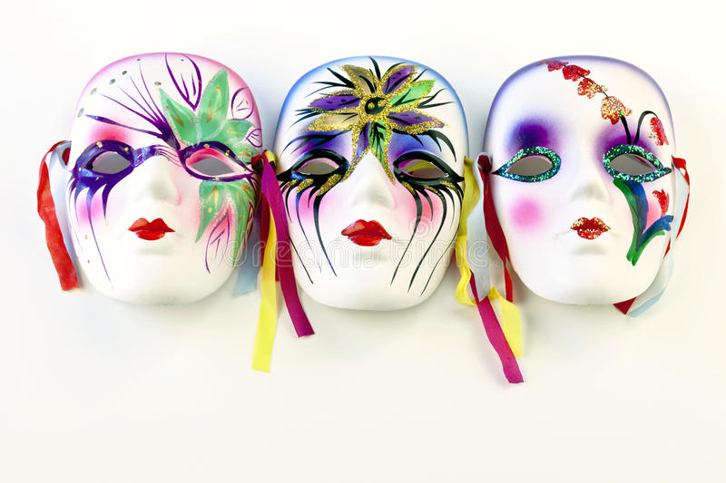 Three Mardi gras masks. Over a white background stock images