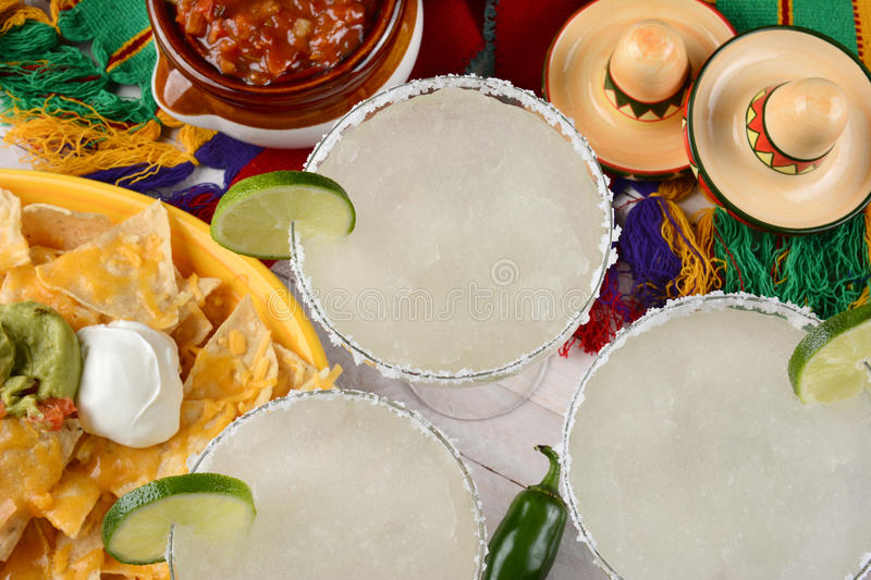Three Margaritas and Nachos stock photos