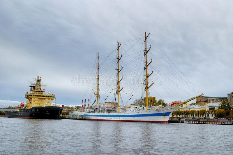 Three-masted ship Mir and icebreaker Moscow at the pier on the Neva river in Saint-Petersburg, Russia royalty free stock images