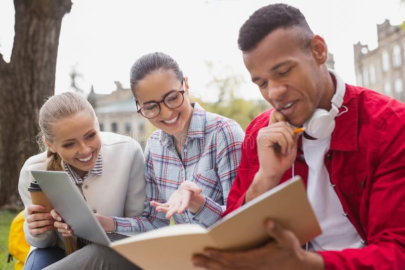 Three math students feeling happy after figuring out problem. Math students. Three smart math students feeling extremely happy after figuring out complicated royalty free stock photos