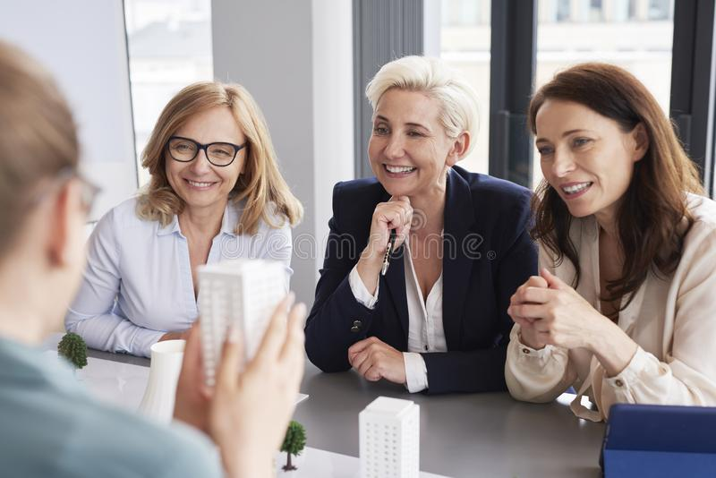 Three mature businesswomen having a conversation at conference table stock photos