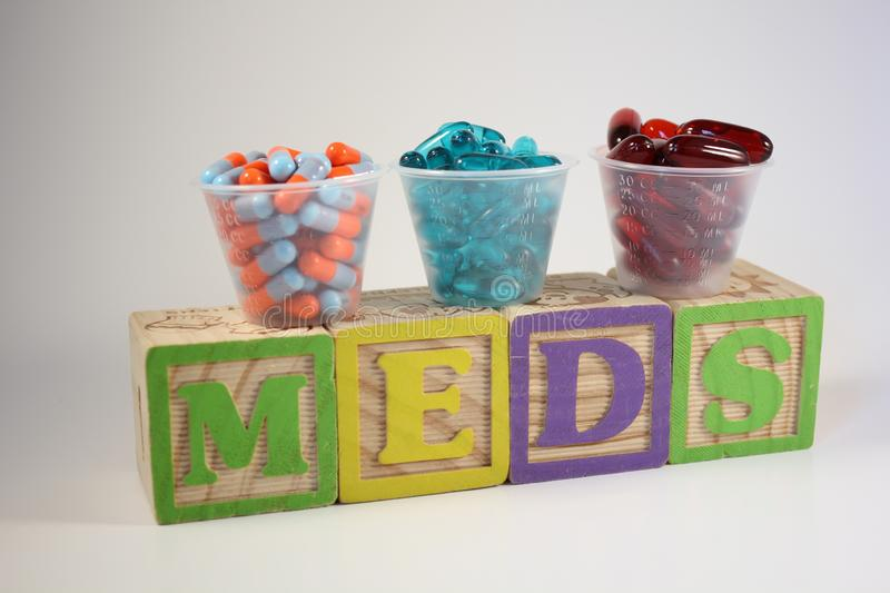 Three Medications on Colorful Blocks stock photography