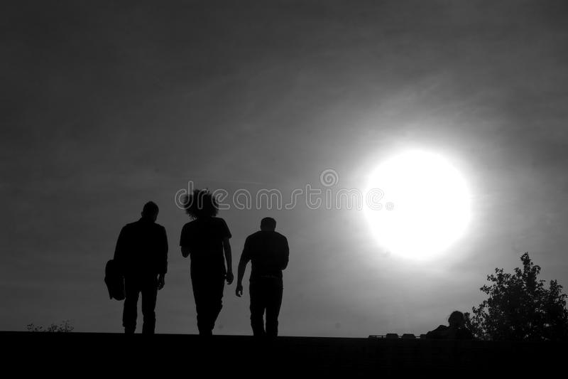 Three men in back light royalty free stock photography