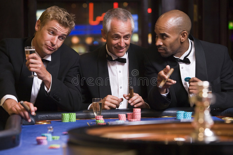 Download Three Men Gambling At Roulette Table Stock Photo - Image: 5213010