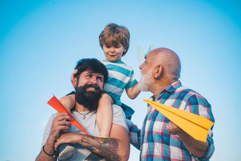 Three men generation. Generation concept. Airplane ready to fly. Three different generations ages: grandfather father stock photos