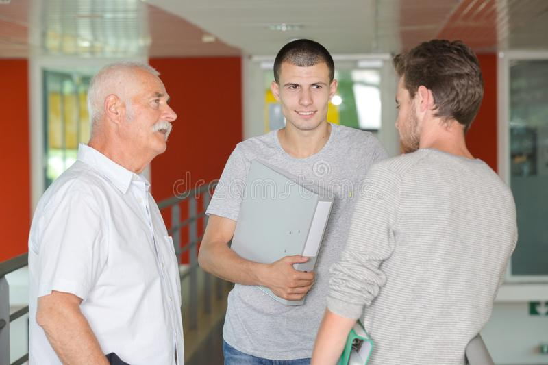 Three men having casual conversation stock photo