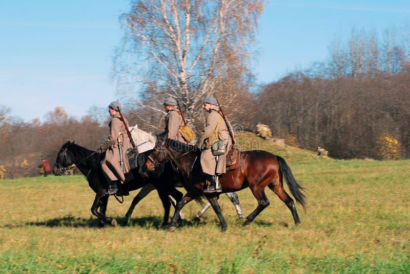 Three men ride horses