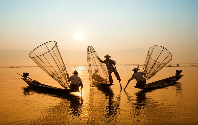 Three Men Riding Boats on Body of Water stock photos