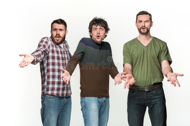 The three men are smiling, looking at camera stock photos