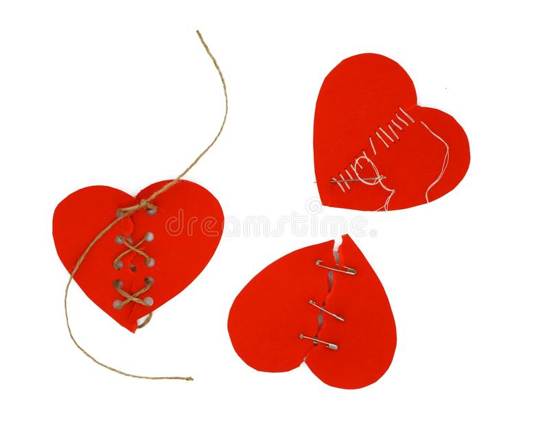 Three mended red hearts. Broken heart concept. stock images