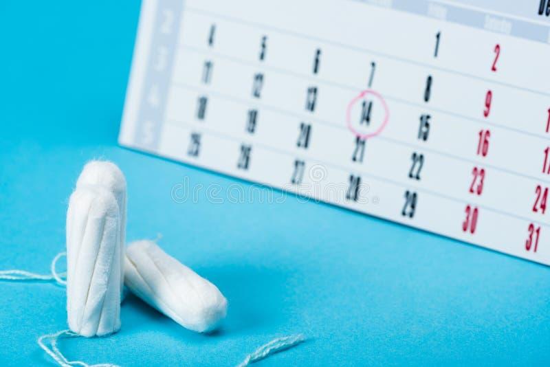 three menstrual tampons and calendar royalty free stock photos