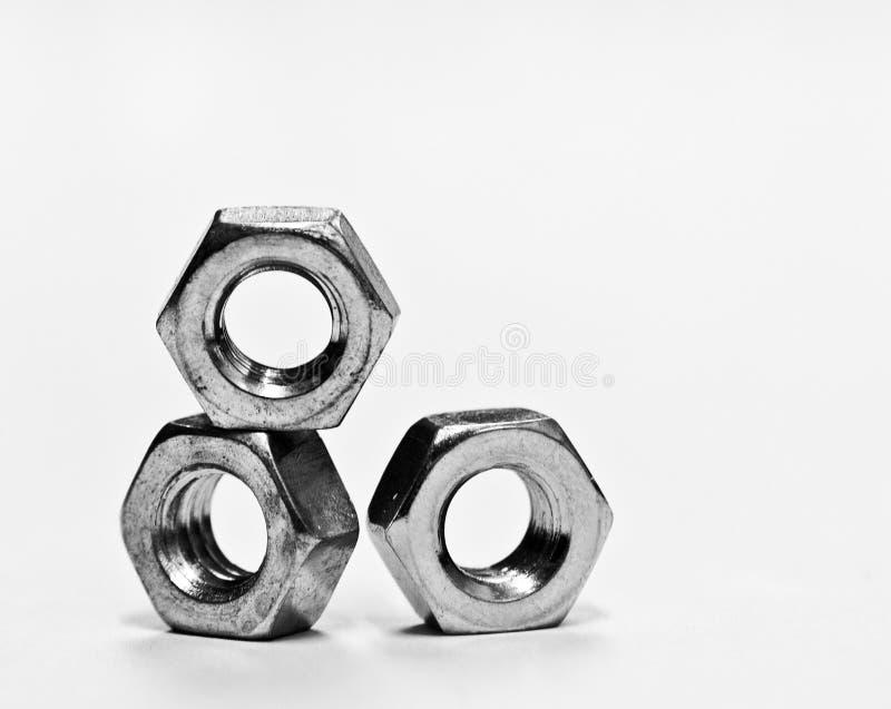 Three metal nuts royalty free stock photos