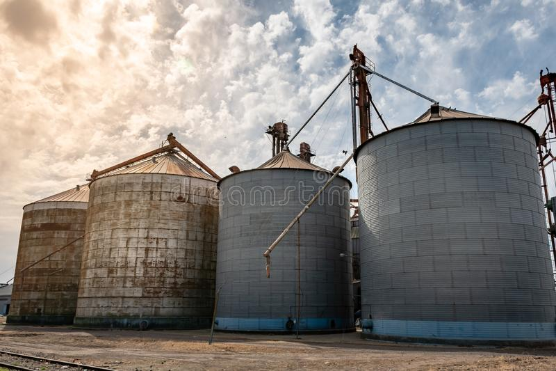 Three metal tanks for storage of grains stock photos