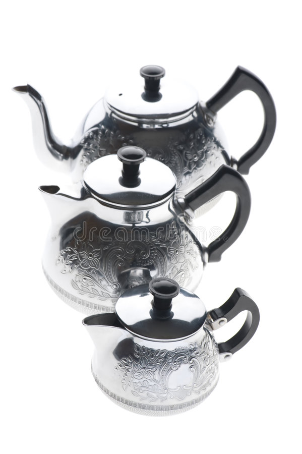 Three metal teapot on white. Object on white - kitchen utensil metal teapot royalty free stock photo