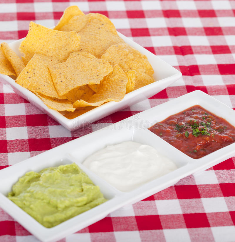 Three mexican dips. And tortilla chips stock photo