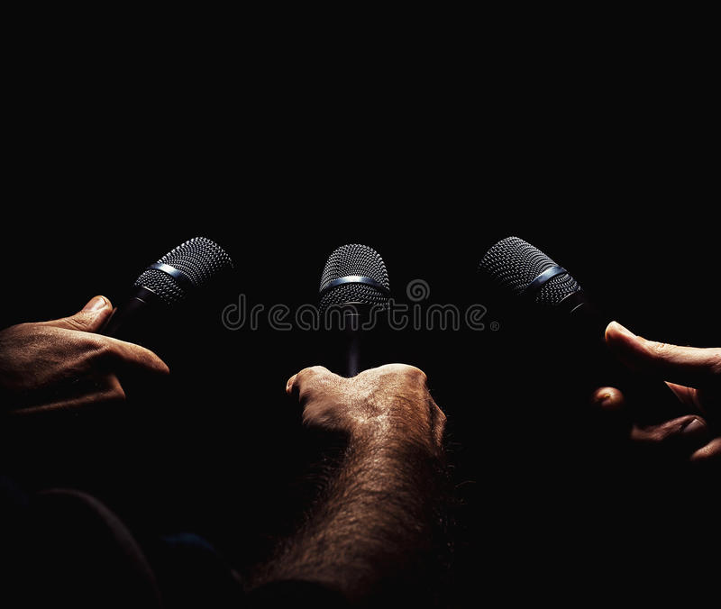 Three Microphones in Hands royalty free stock photo