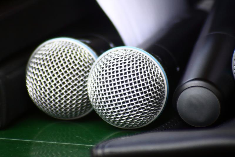 Three microphones on the table close up royalty free stock photo