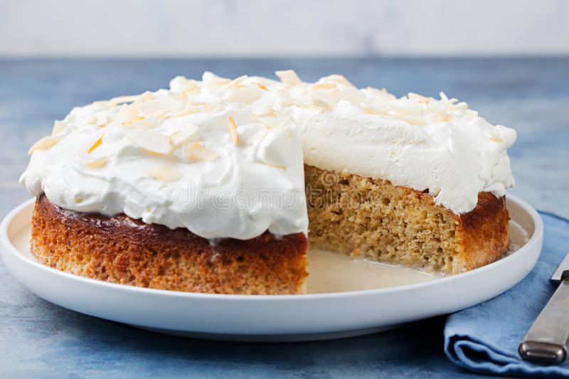 Three milk cake, tres leches cake with coconut. Traditional dessert of Latin America. stock image