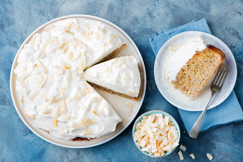 Three milk cake, tres leches cake with coconut. Traditional dessert of Latin America Top view. Copy space stock photos