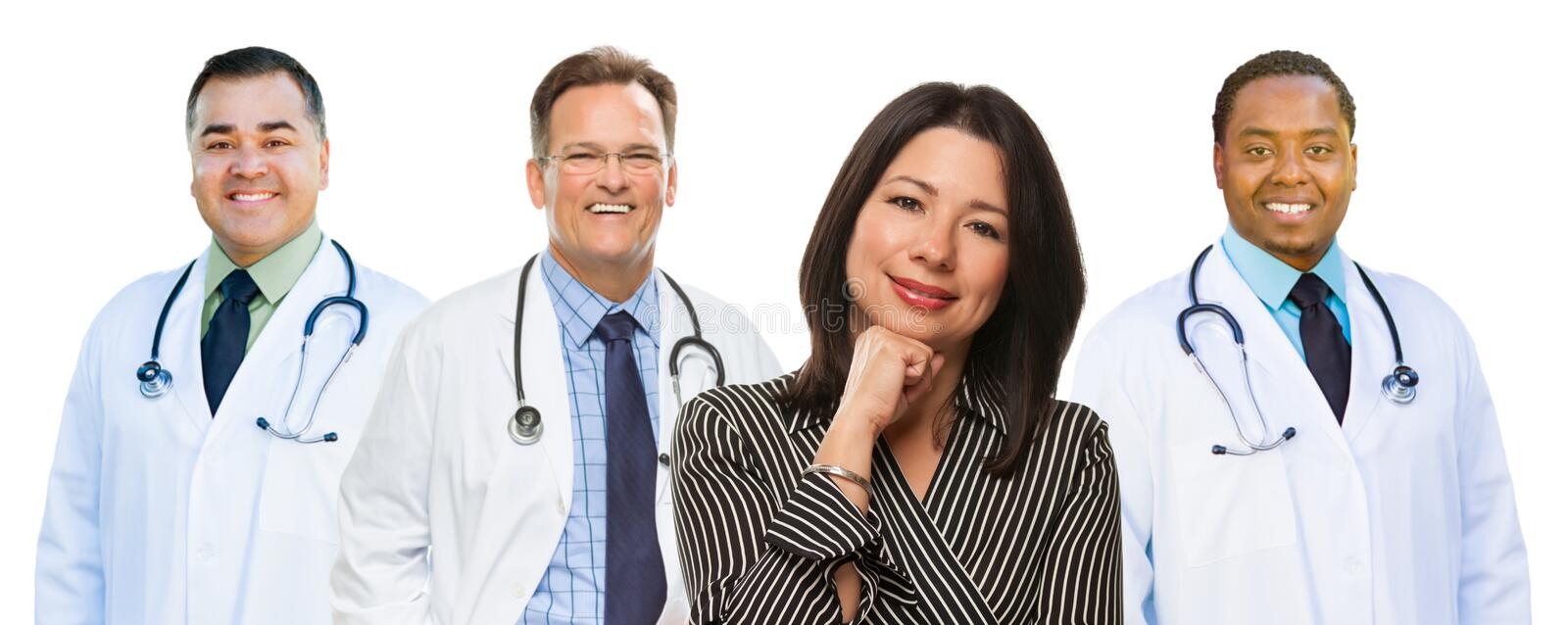 Three Mixed Race Doctors Behind Hispanic Woman on White. Group of Mixed Race Doctors Behind Hispanic Woman Isolated on a White Background stock images