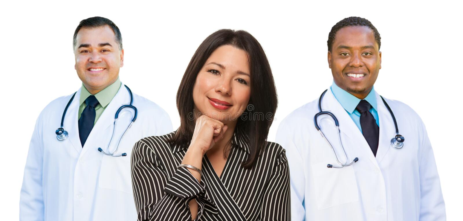 Three Mixed Race Doctors Behind Hispanic Woman on White. Mixed Race Doctors Behind Hispanic Woman Isolated on a White Background stock images