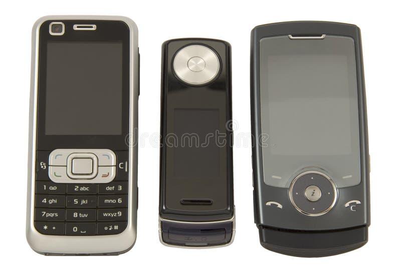 Three mobile phones stock image