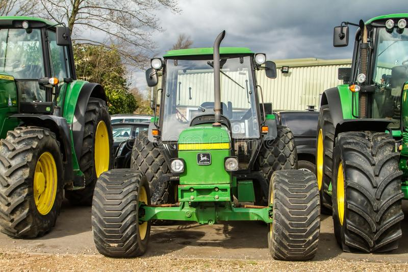 Three Modern John Deere tractors royalty free stock images