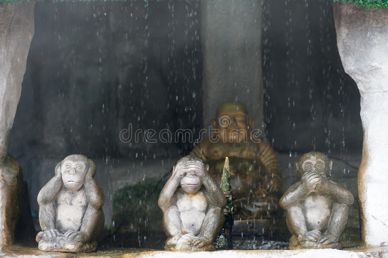 Three monkey,close up of hand small statues with the concept of stock photography