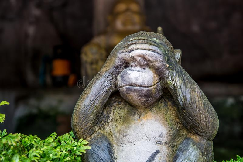 Statues of monkeys. Three monkey,close up of hand small statues with the concept of see no evil, hear no evil and speak no evil stock images