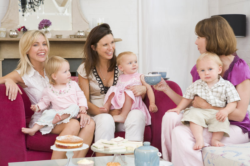 Three mothers with babies stock images