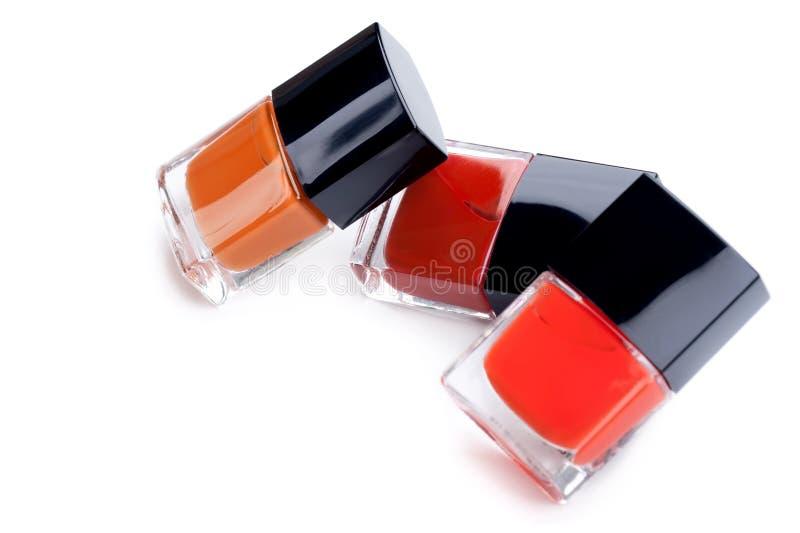 Three nail polish bottles, closeup shot royalty free stock images