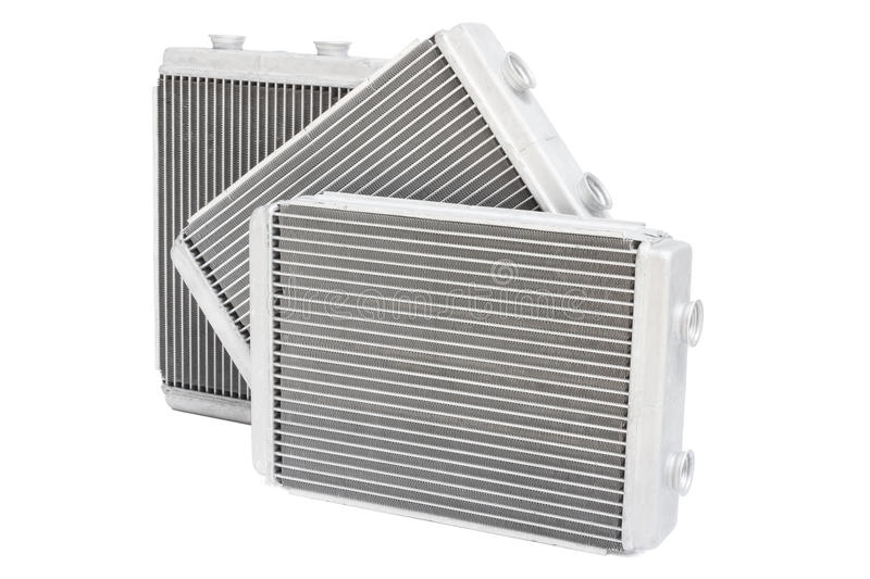 Three new automotive radiator stove on a white background royalty free stock image