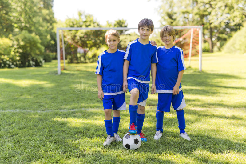 Three, Young boy with soccer ball on a sport uniform royalty free stock photo