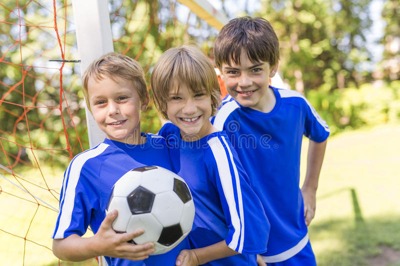 Three, Young boy with soccer ball on a sport uniform stock image