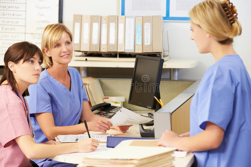 Three Nurses Working At Nurses Station royalty free stock images