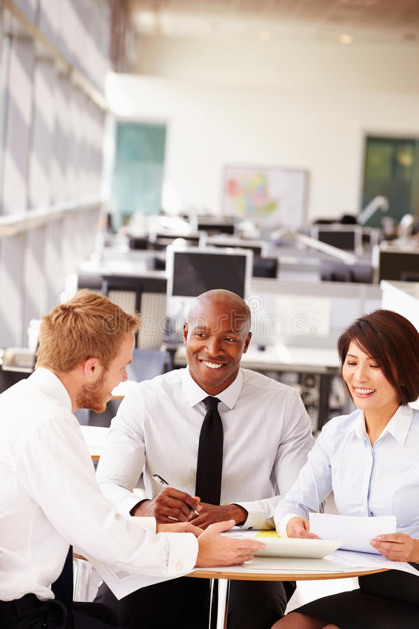 Three office colleagues in a casual team meeting stock image