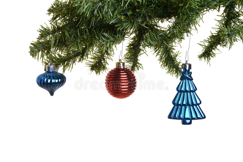 Three old christmas ornaments on branch stock photos