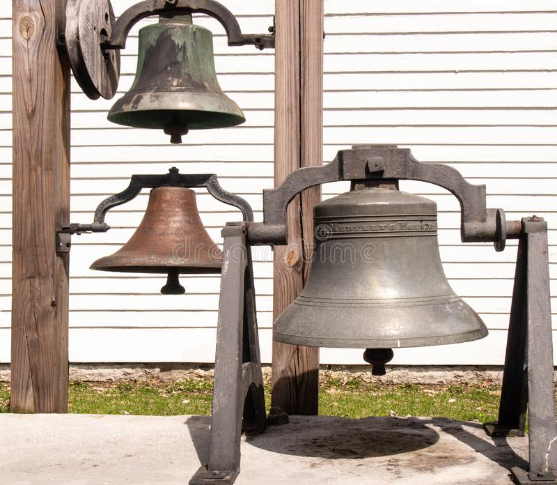 Three old fashioned church bells stock photo