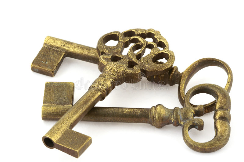Three old keys. Close-up of three ornamented old keys isolated on white background stock images