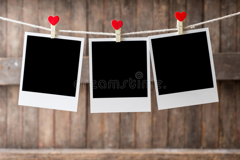 Three Old picture frame hanging on the clothesline stock photo