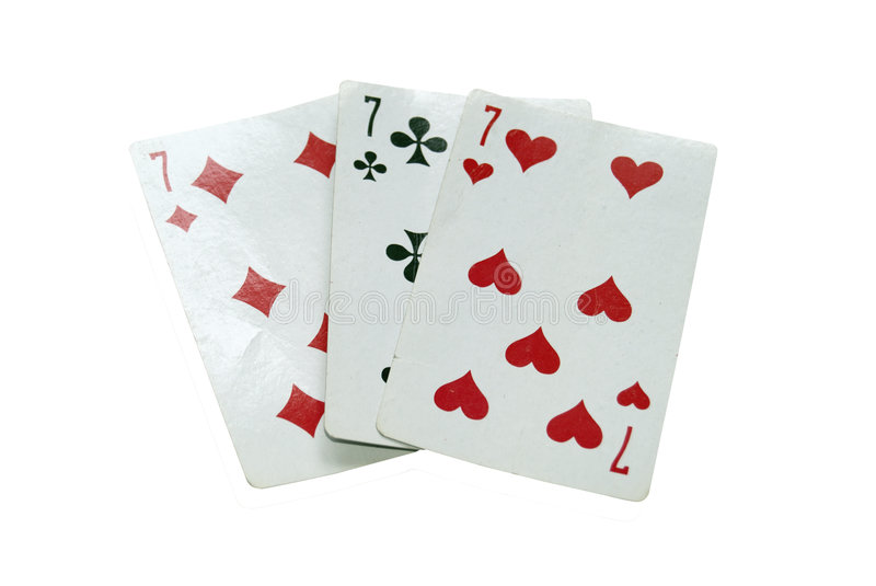 Three old playing cards, three seven. Photo of three old playing cards, three seven stock image