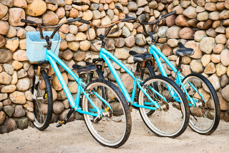 Three old, rusty blue bicycles stock photo
